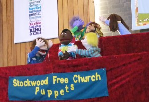 "The service was opened by our Puppet Group singing ""Our church"""